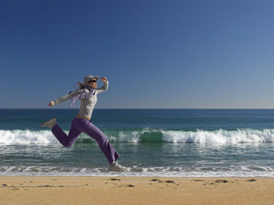 running on the beach happy